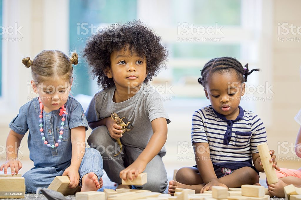 Preschoolers Playing with Blocks stock photo