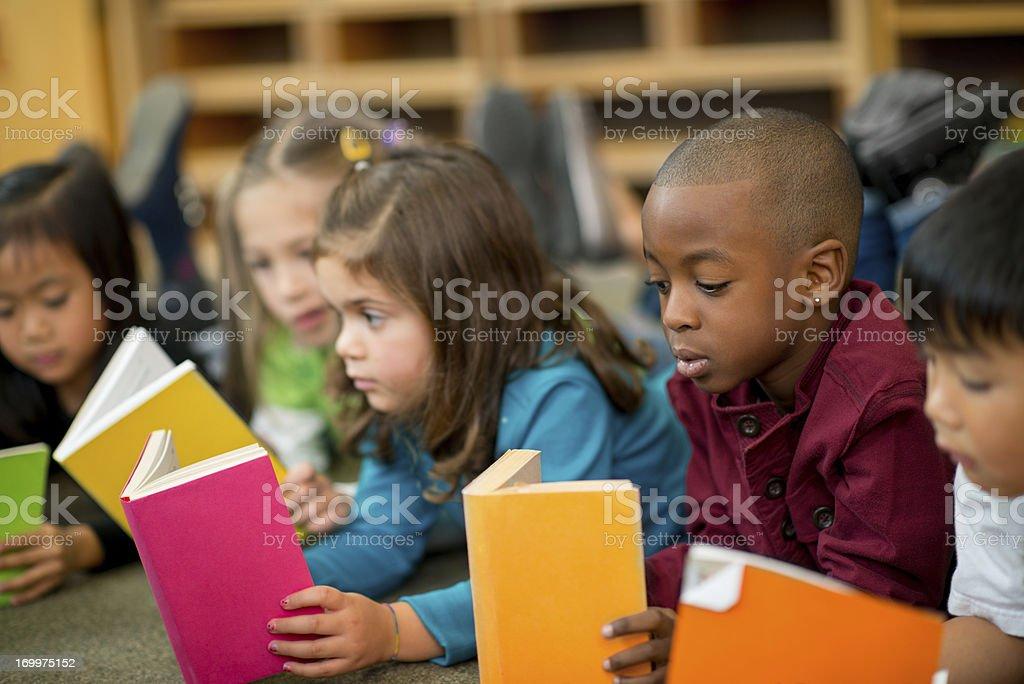 Pre-schoolers reading stock photo