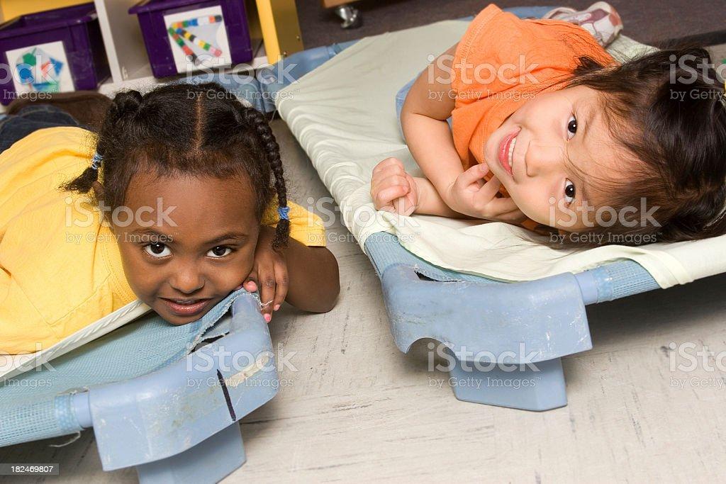 Preschoolers resisting naptime stock photo
