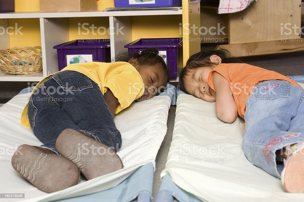Preschoolers taking a nap stock photo