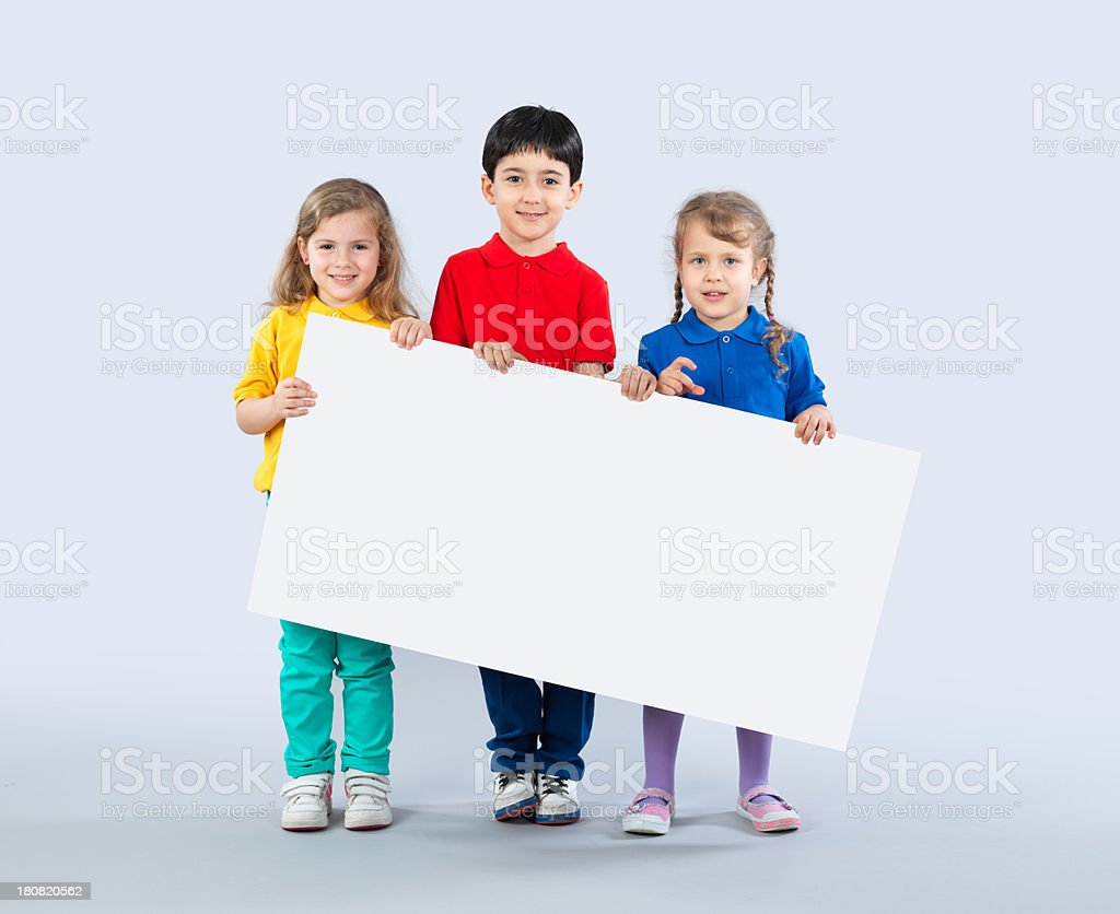 Preschoolers With Blank Sign royalty-free stock photo