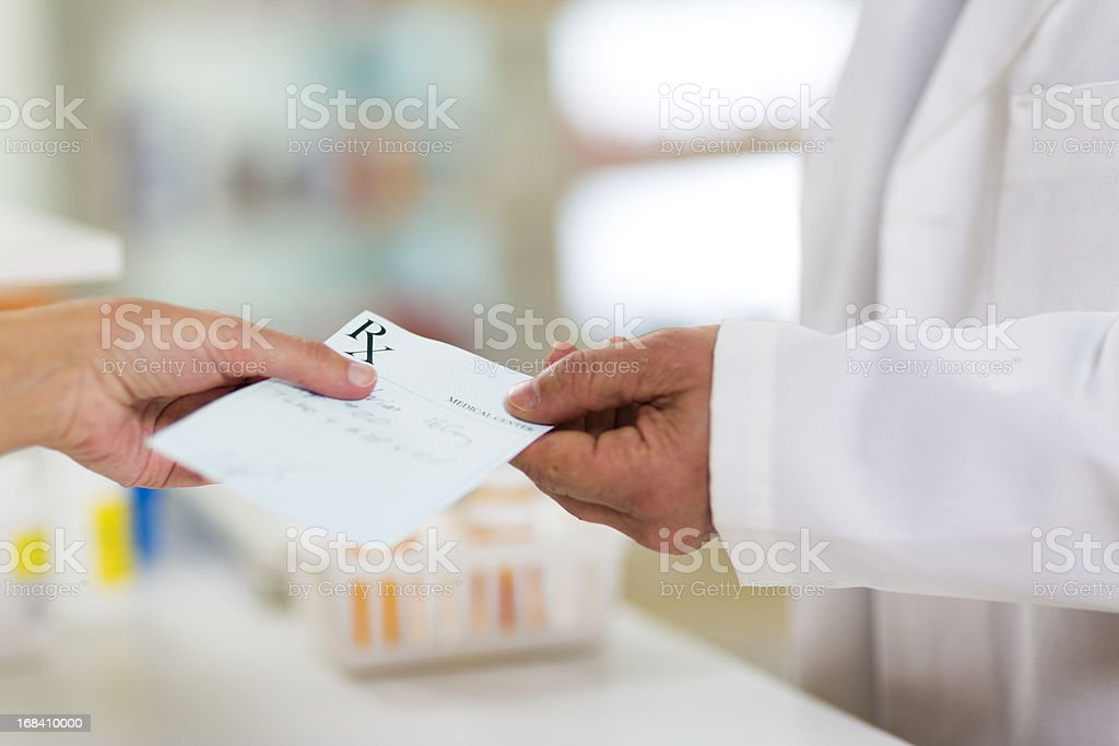 Prescription Being Given to Pharmacist stock photo