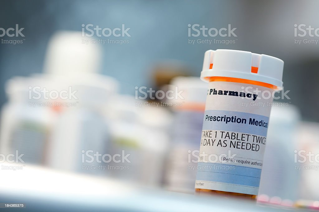 Prescription drug bottle on countertop stock photo