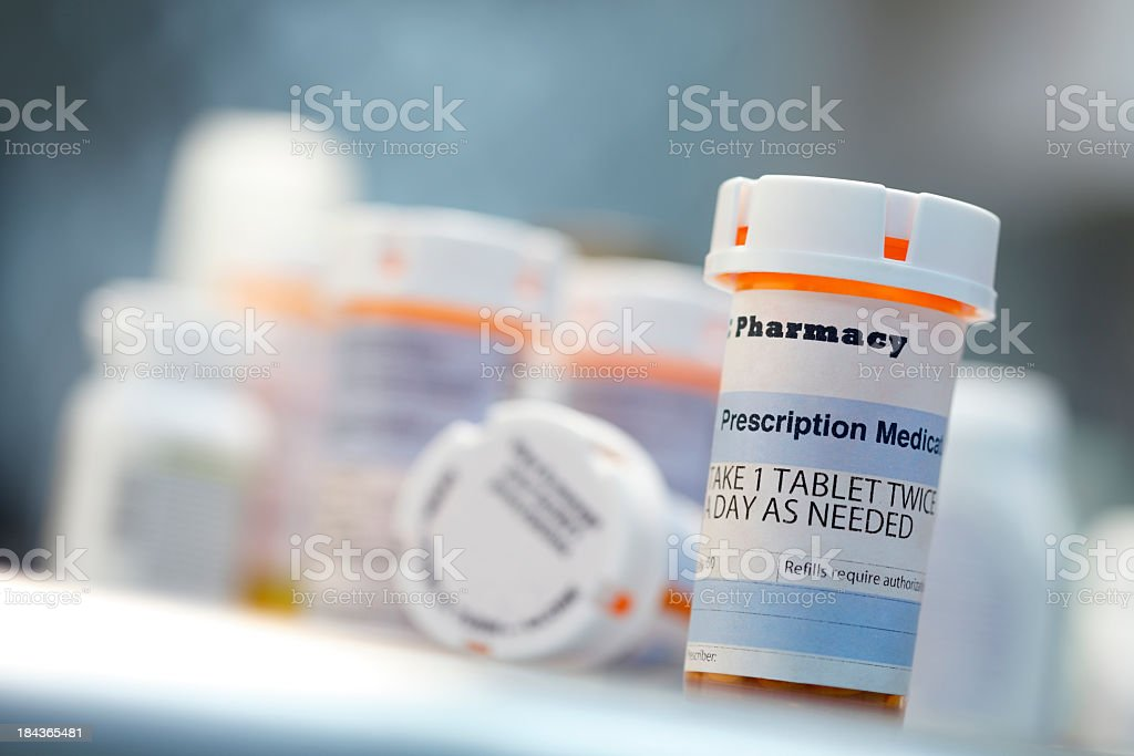 Prescription drug bottles sitting on countertop stock photo