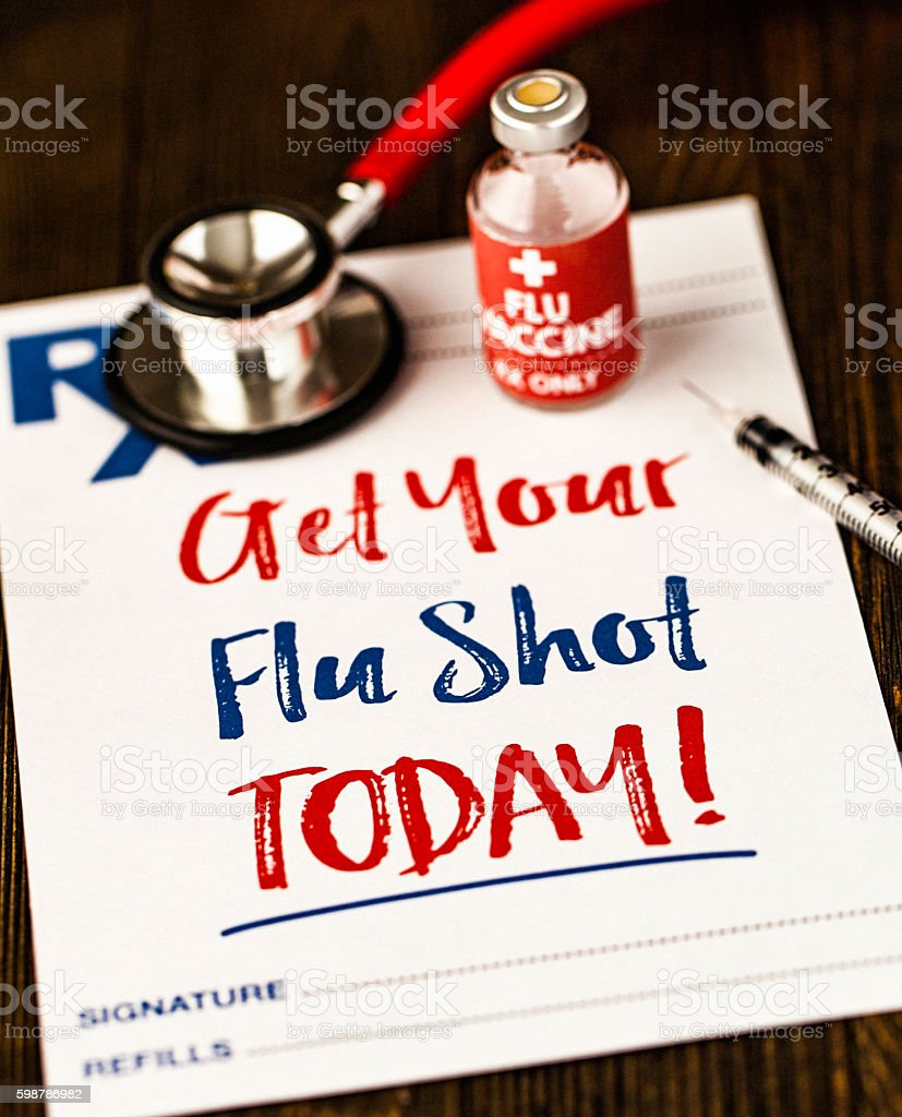 Prescription form with reminder to get a flu shot stock photo