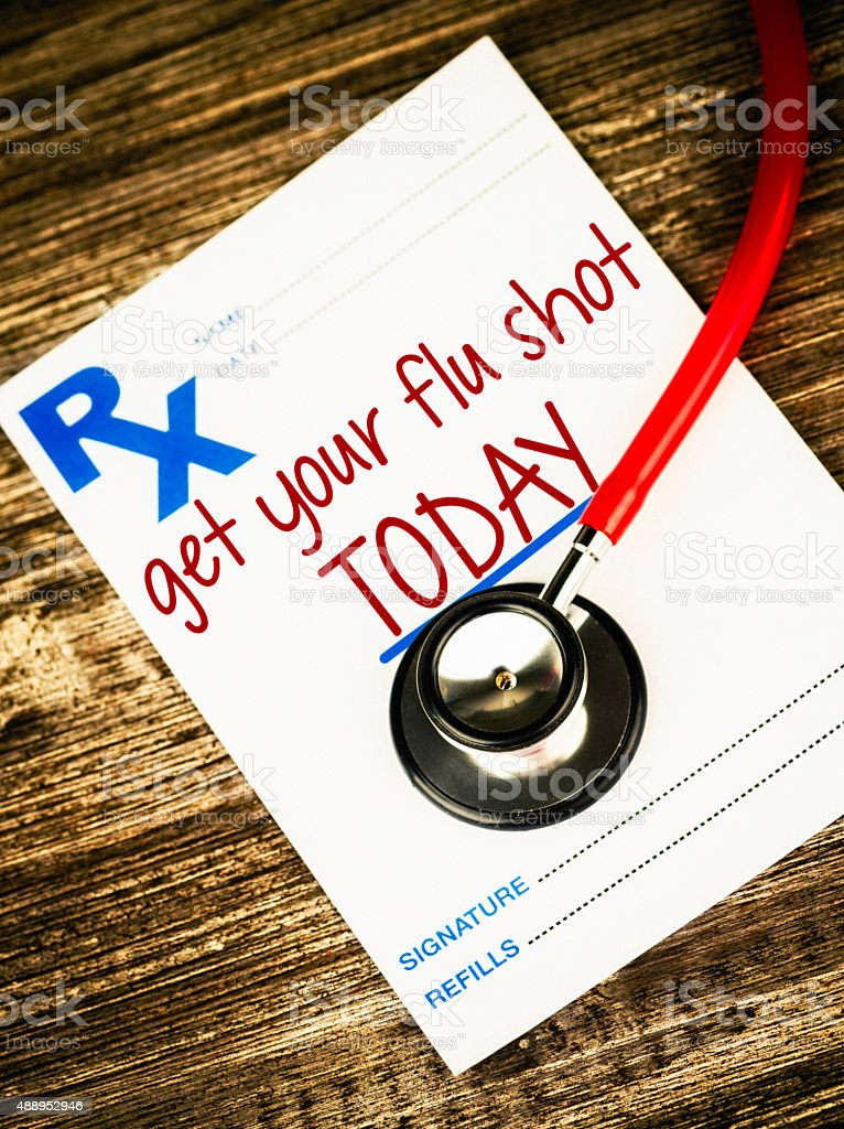 Prescription form with reminder to get flu shot today stock photo
