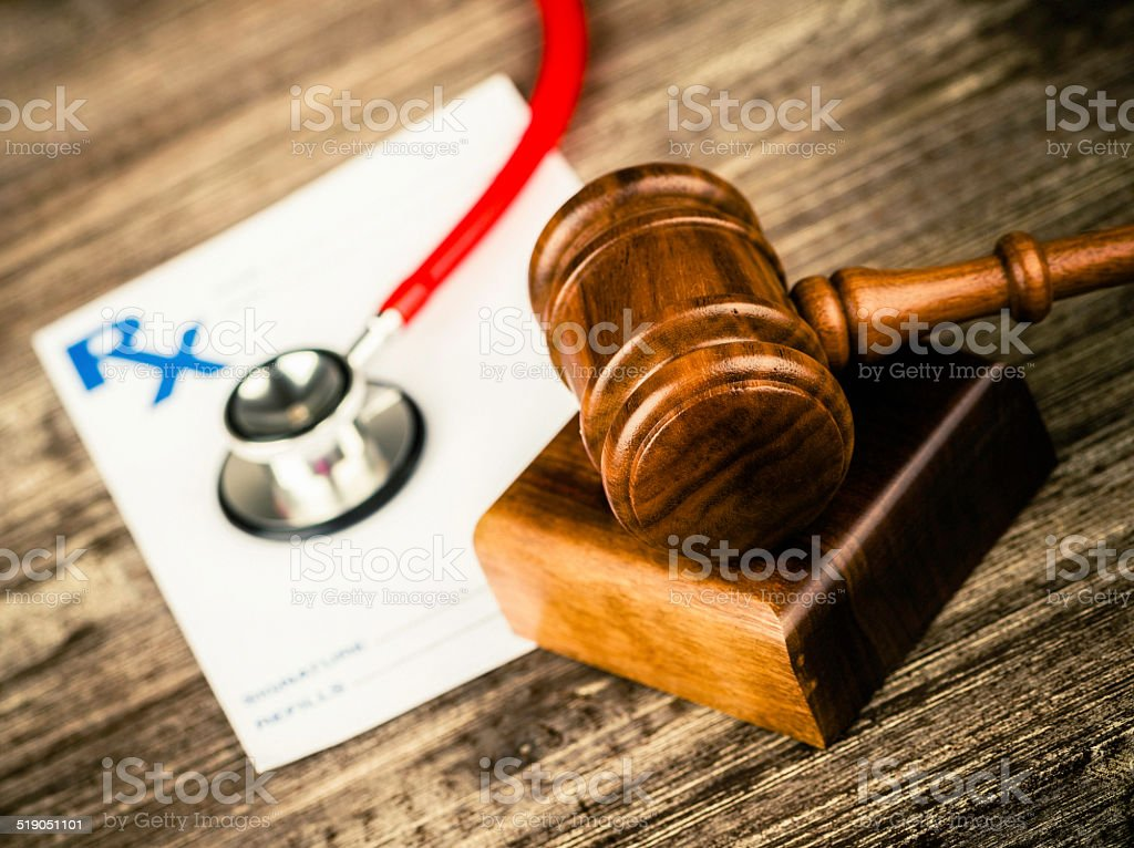 Prescription form with stethoscope and gavel. Medical Malpractice. stock photo