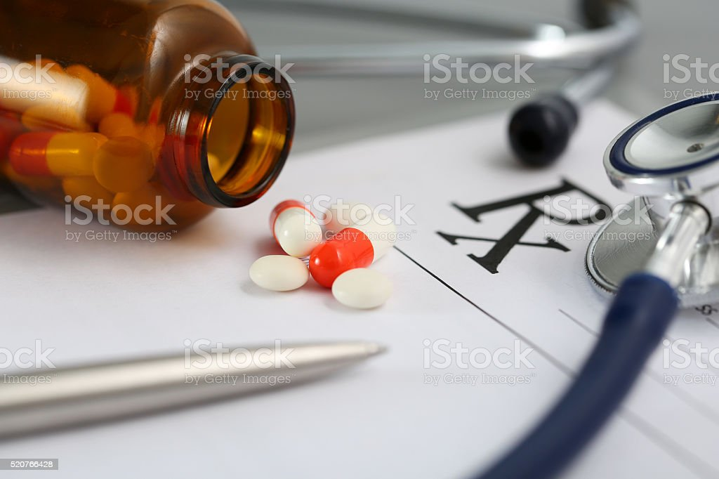 Prescription lying on table with stethoscope stock photo
