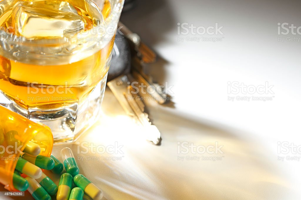 Prescription Medication And Shot Glass In Front Of Car Keys stock photo