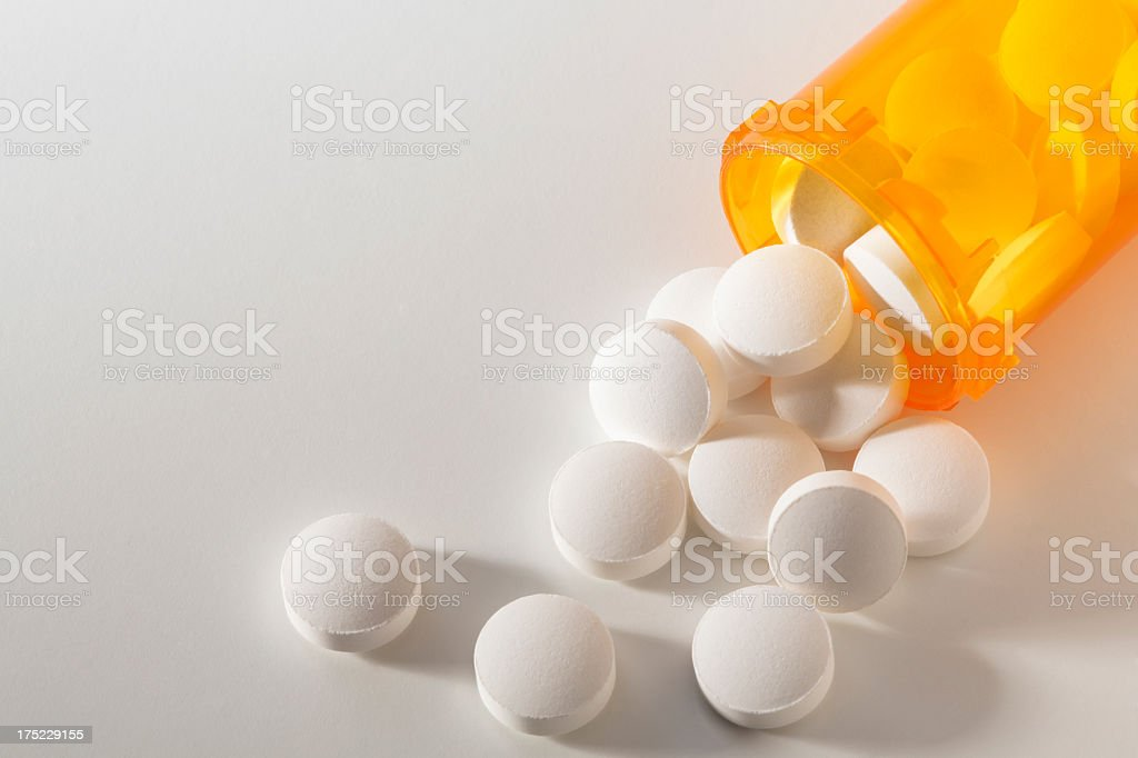 Prescription Medicine Spilling From an Open Bottle stock photo