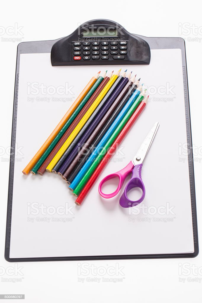 prescription pad with colorful pencils and scissors stock photo