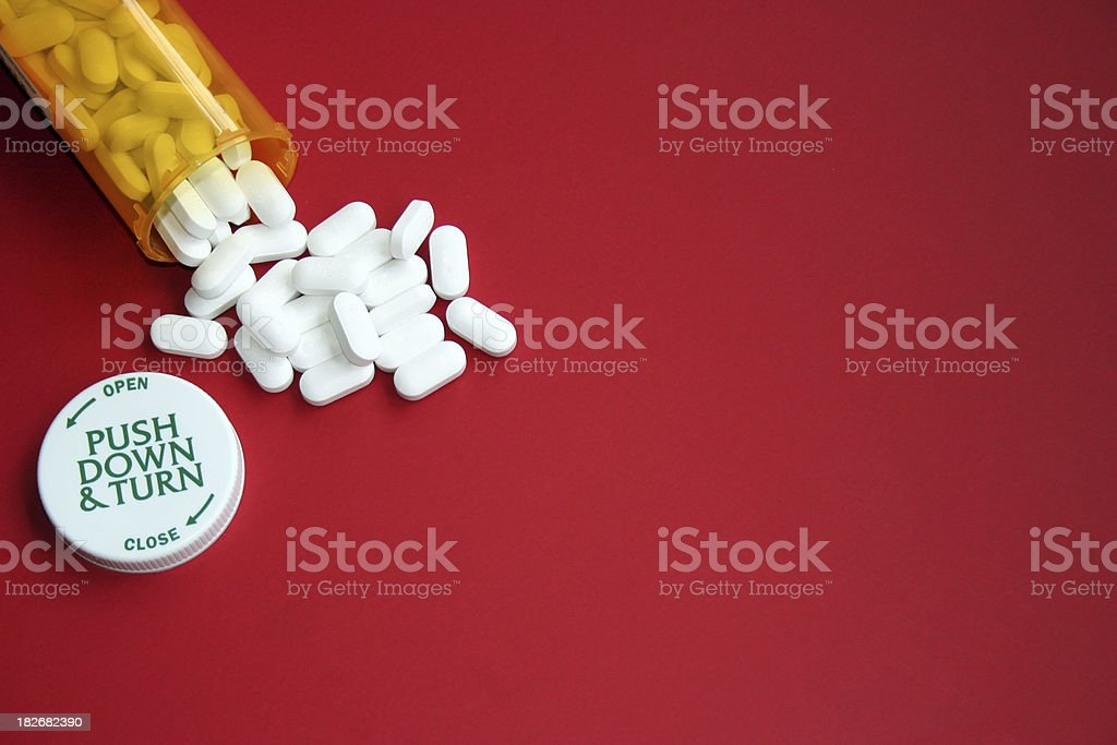 Prescription Pills on Red stock photo