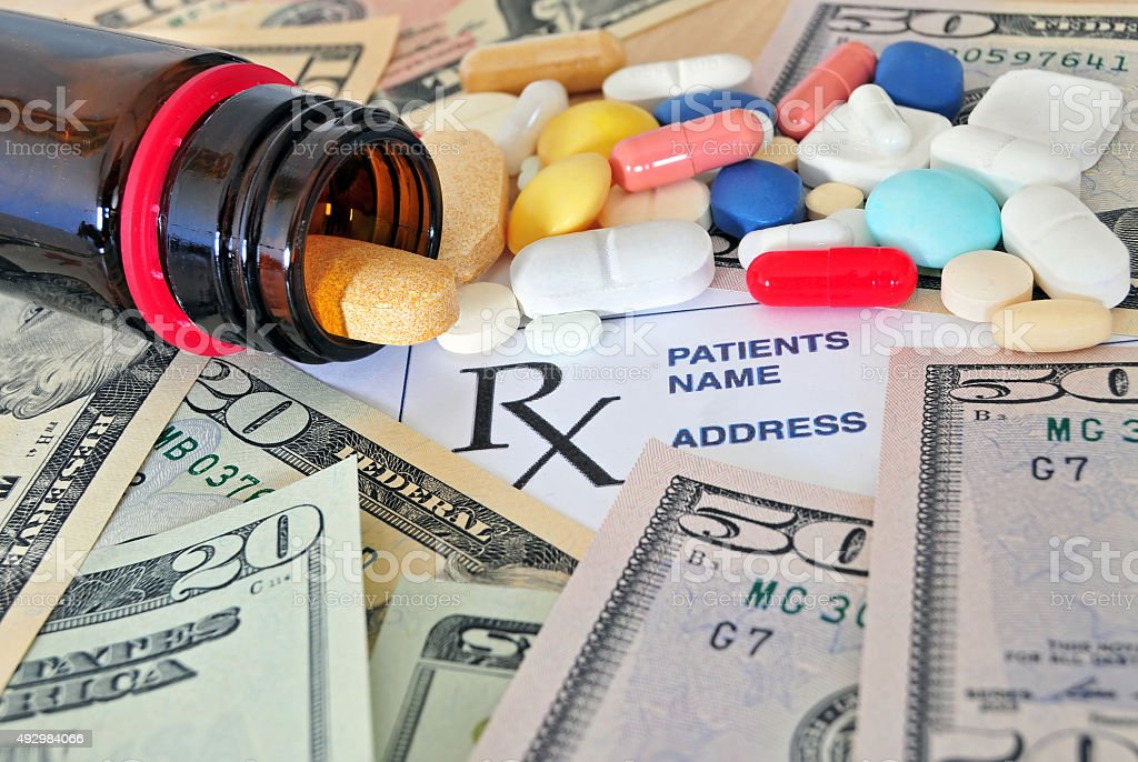 Prescription pills with money stock photo