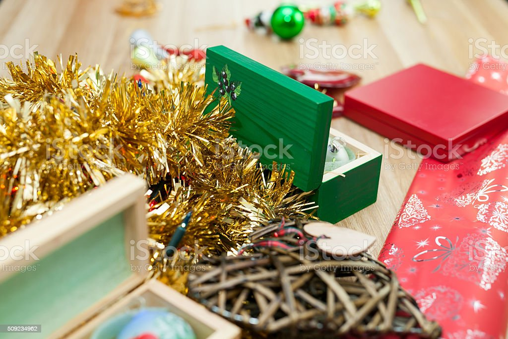 Present and christmas ornaments on a wooden table. Christams stock photo
