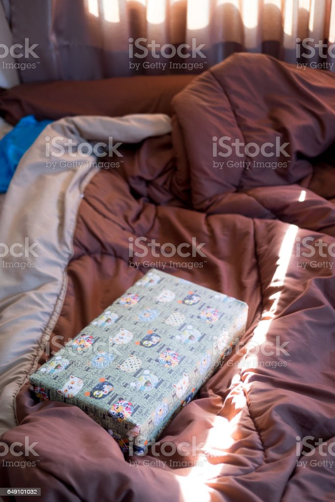 present box in the bed, lazy morning, valentines day stock photo