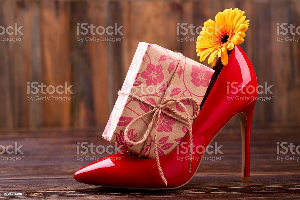 Present box near shoe. stock photo