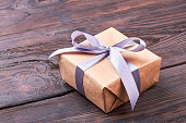 Present box on wooden surface.