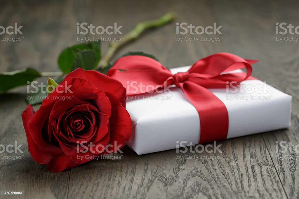 present box with ribbon bow and rose stock photo