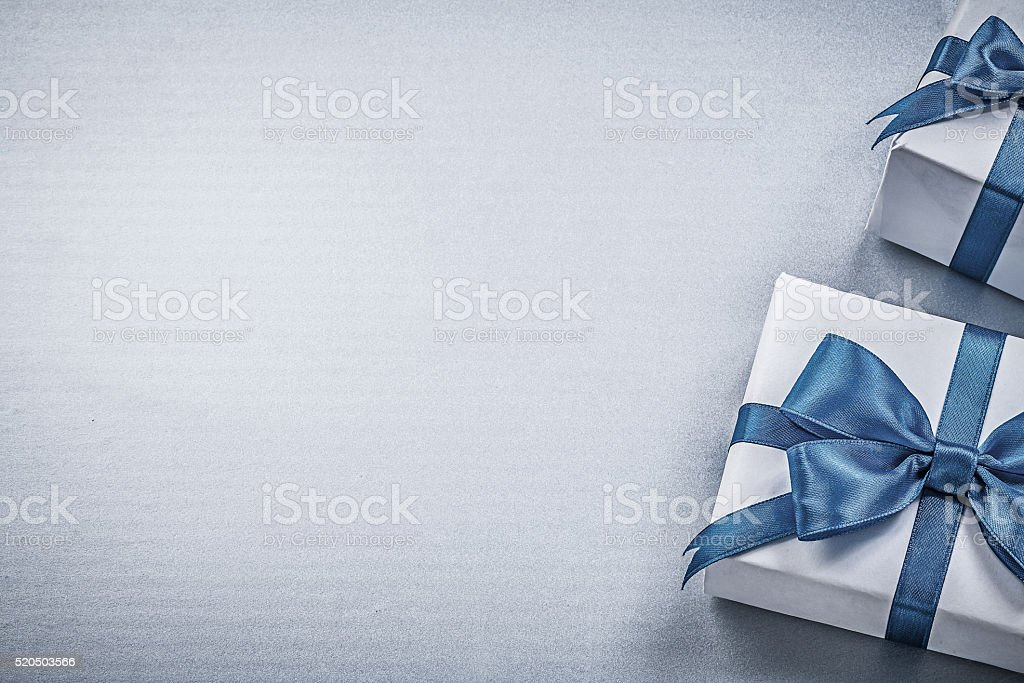 Present boxes on blue background greeting card holidays concept stock photo