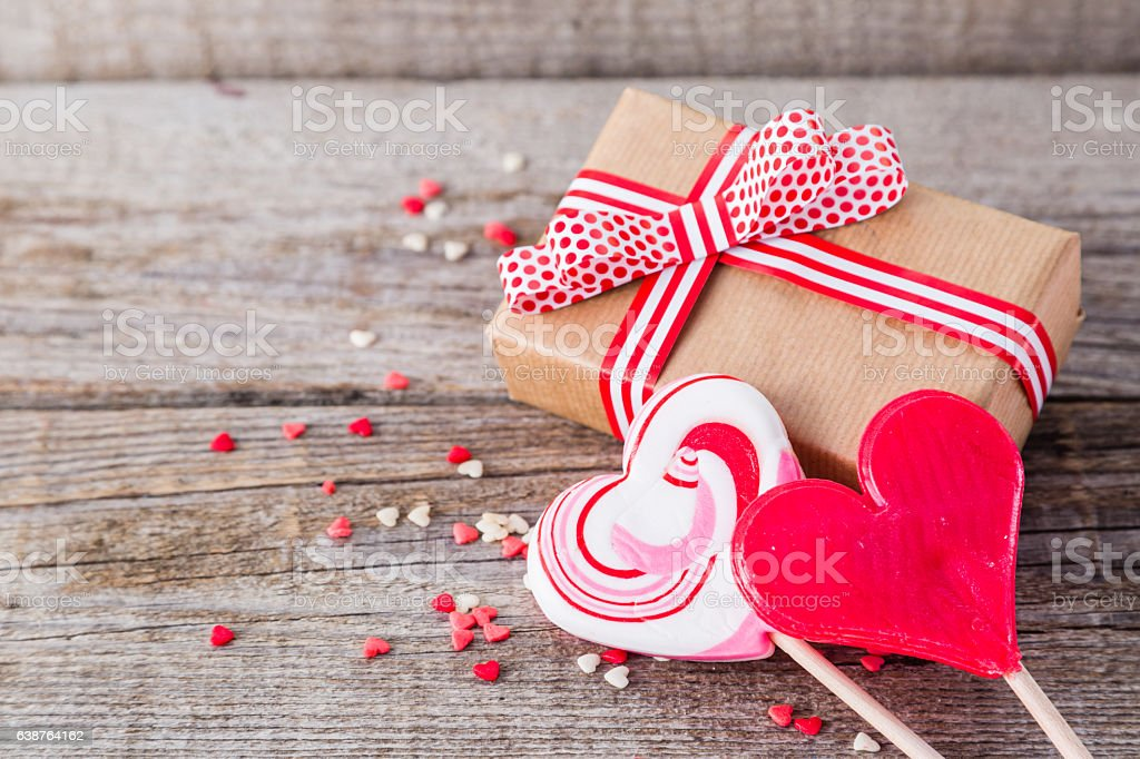 Present for Valentine's day with heart shaped sweets stock photo