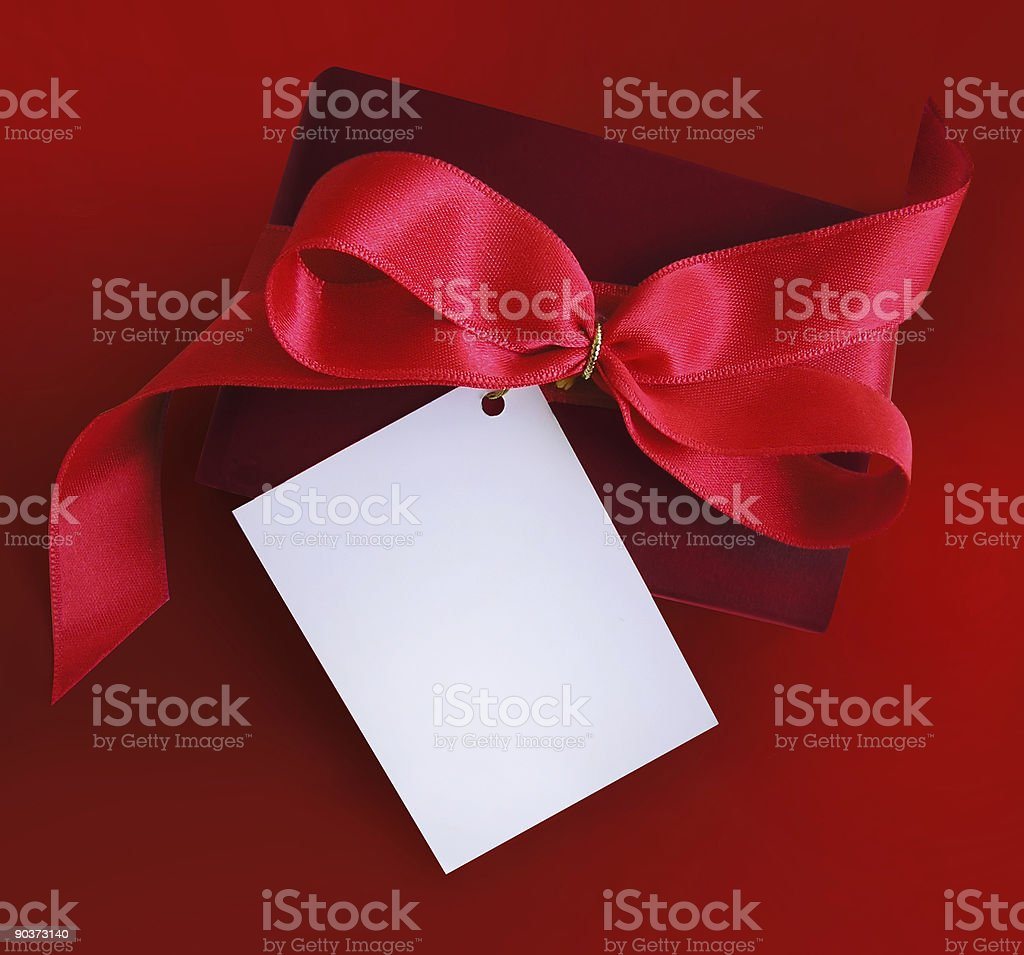 Present with red ribbon and card. royalty-free stock photo