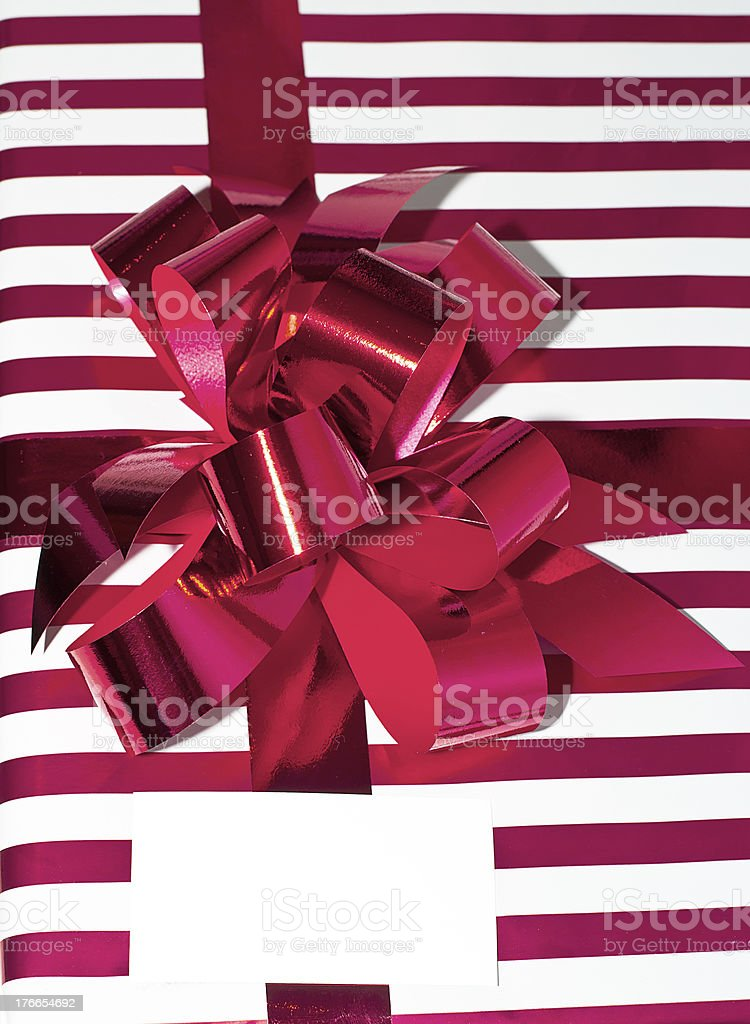 Present with Ribbon and tag. Isolated on white background stock photo