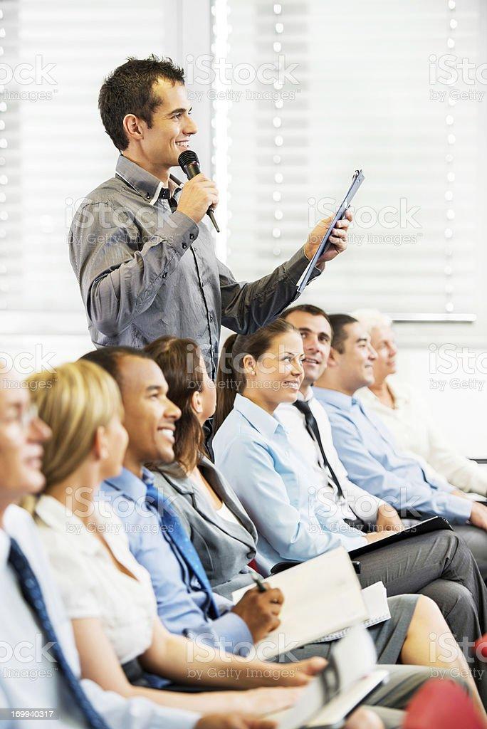Presenter giving a public speech. royalty-free stock photo