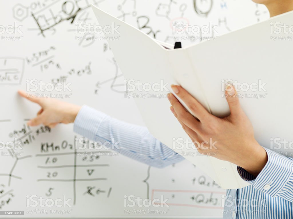 Presenter with a file in front of white board. stock photo