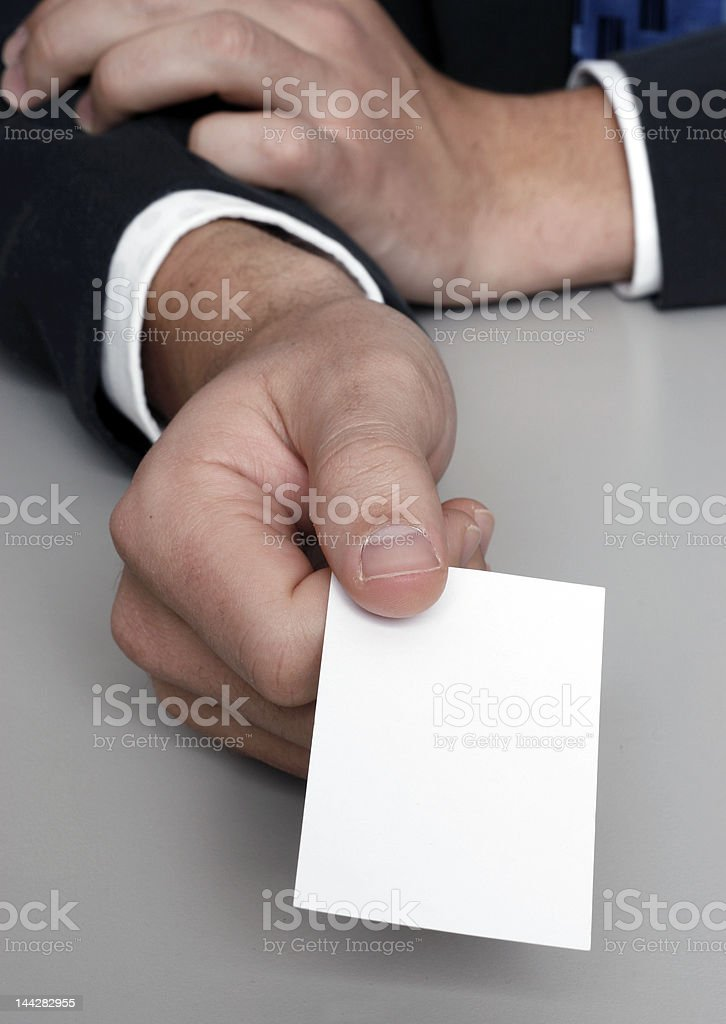 Presenting a blank business card royalty-free stock photo