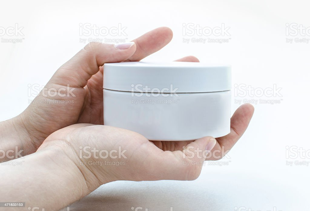 Presenting a blank moisturiser tub royalty-free stock photo