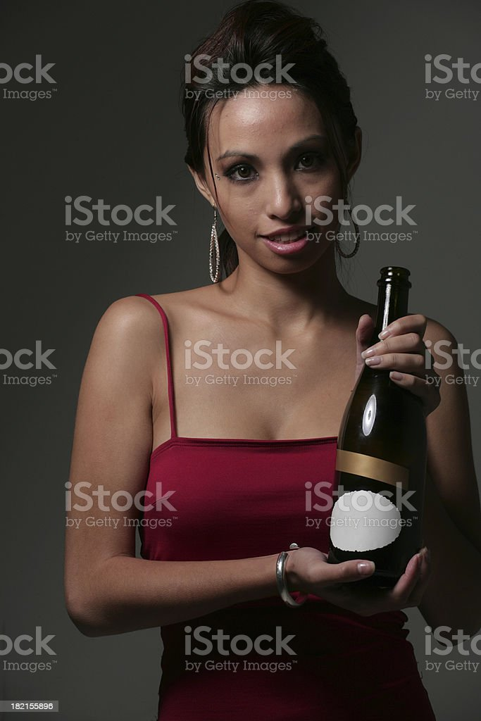 Presenting a bottle of champagne royalty-free stock photo
