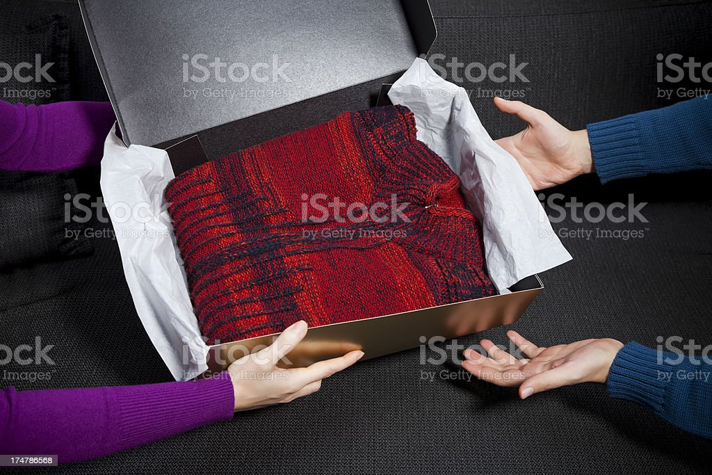 presenting a gift royalty-free stock photo