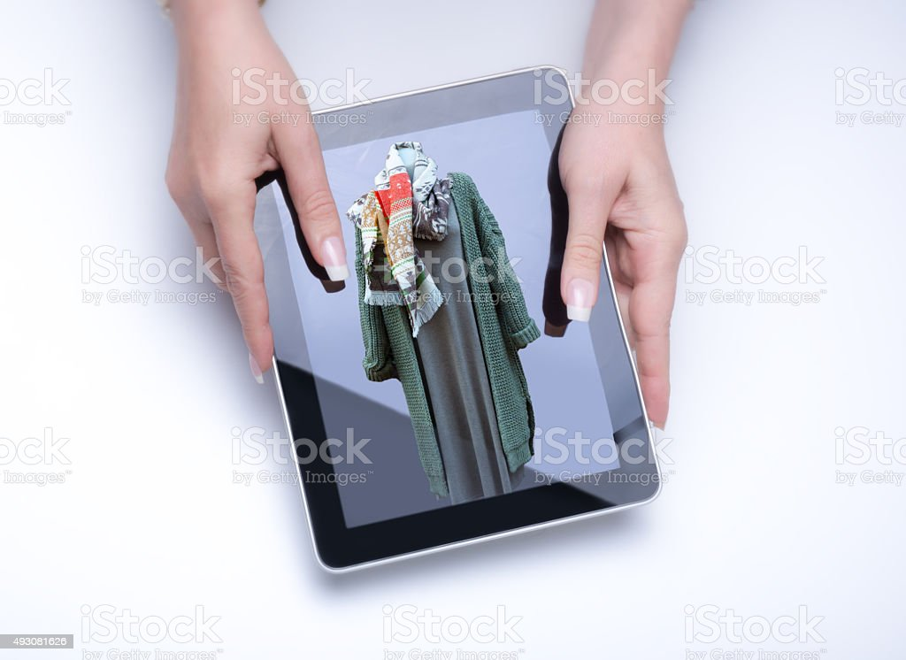 Presenting a green winter outfit stock photo