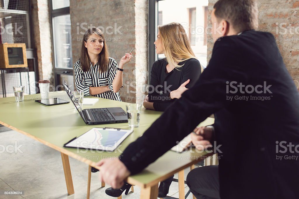 Presenting Her Ideas To The Team stock photo