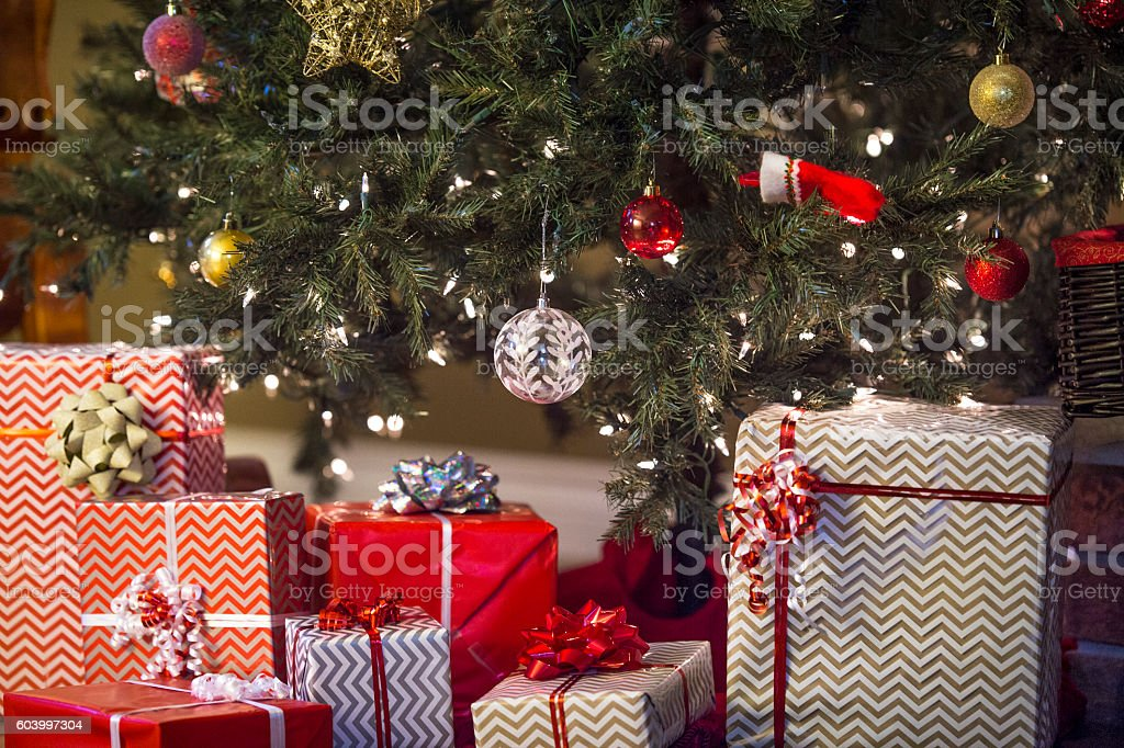 Presents Stacked Beneath the Tree stock photo