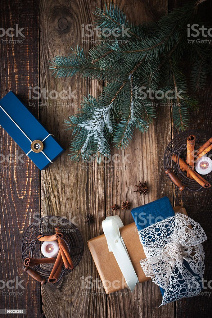 Presents with fir tree , spices and candles vertical stock photo