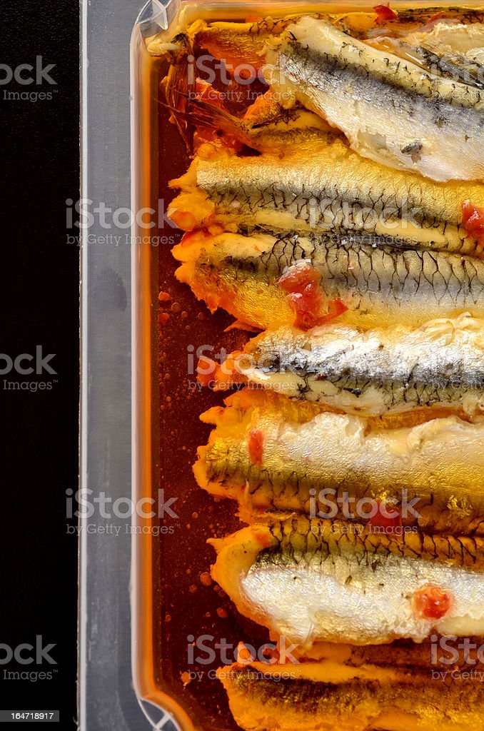 Preserved anchovy fillets in chili oil stock photo