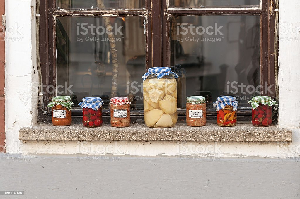 Preserved fruits and vegetables on a windowsill stock photo