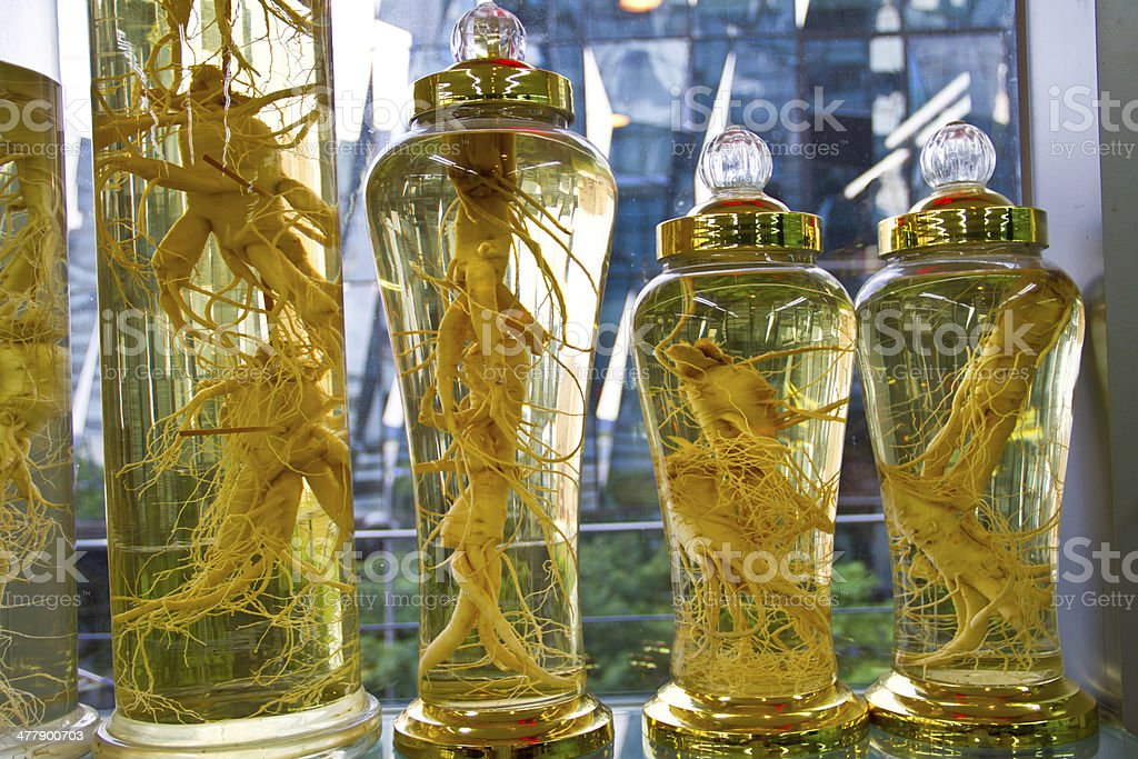 Preserved ginseng in jars royalty-free stock photo