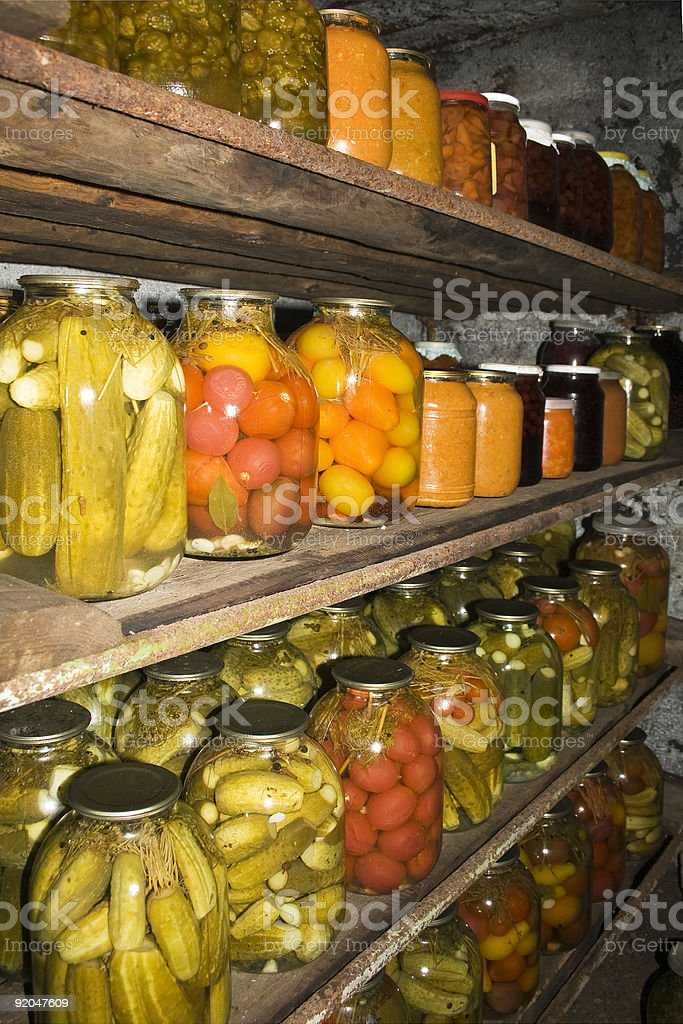Preserved in jars vegetables arranged on shelf's royalty-free stock photo