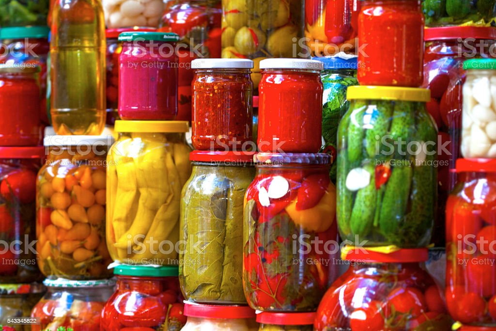Preserved vegetables in glass jars stock photo
