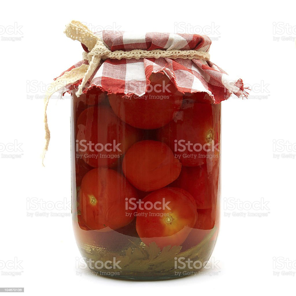 Preserves. Pickled tomato in glass isolated on white royalty-free stock photo