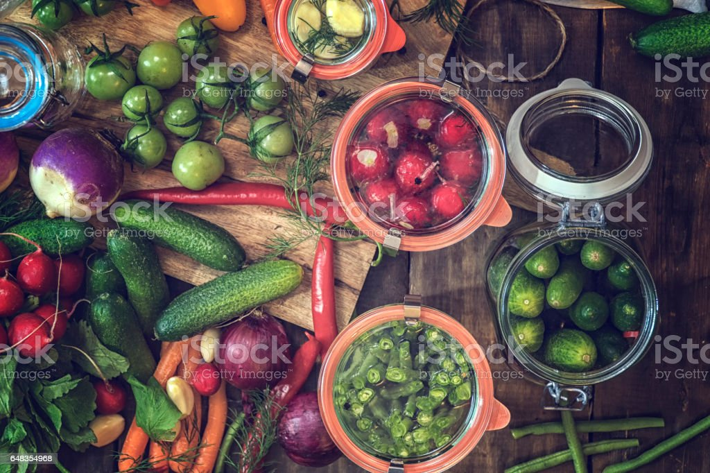 Preserving Organic Vegetables in Jars stock photo