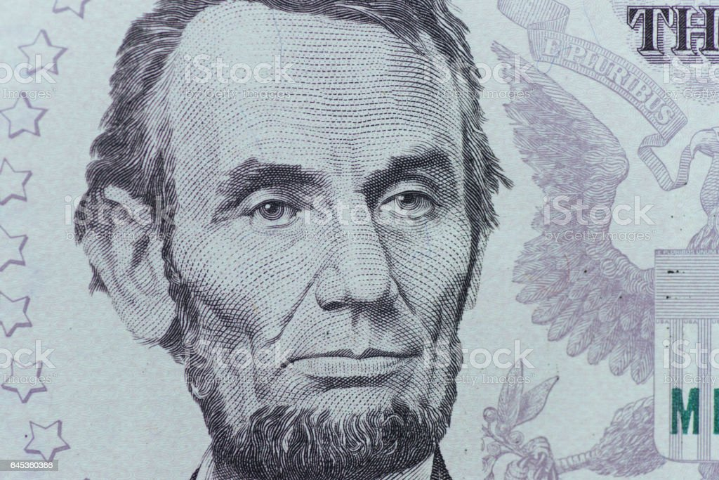 US President Abraham Lincoln face on five dollar bill macro, 5 u stock photo