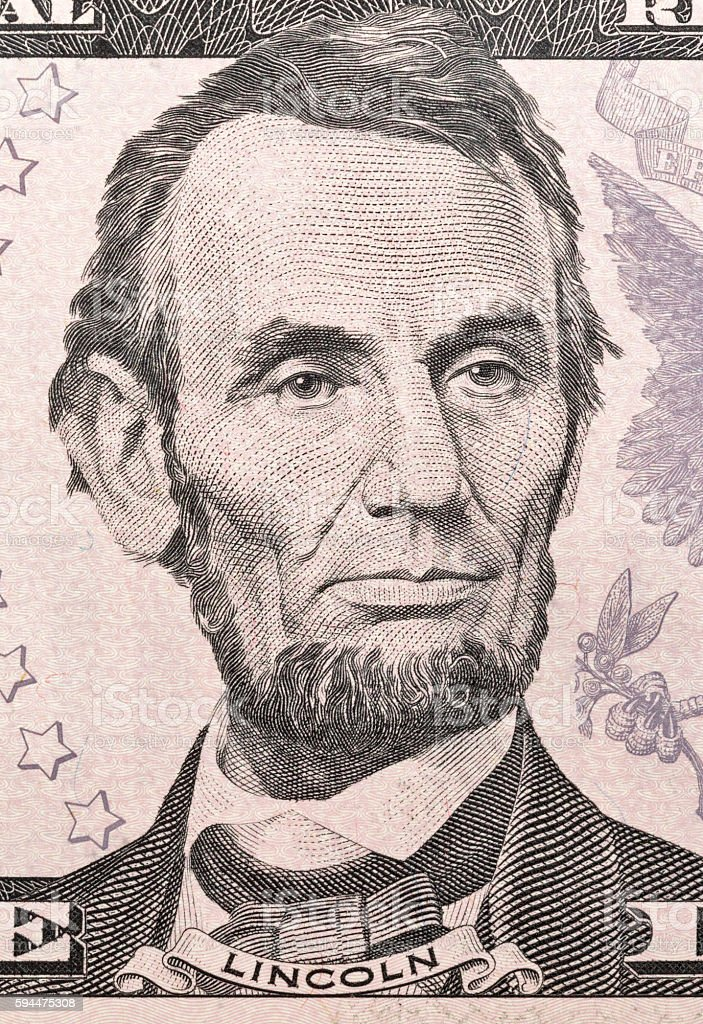 US President Abraham Lincoln on five dollar bill macro stock photo