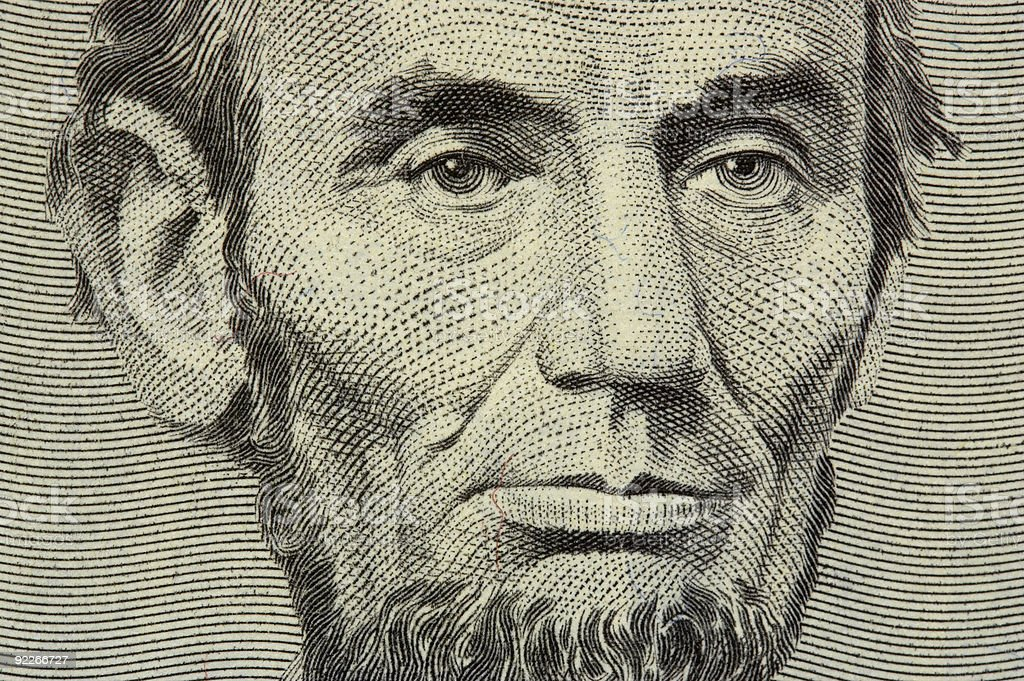 president Lincoln face on the five dollar bill stock photo