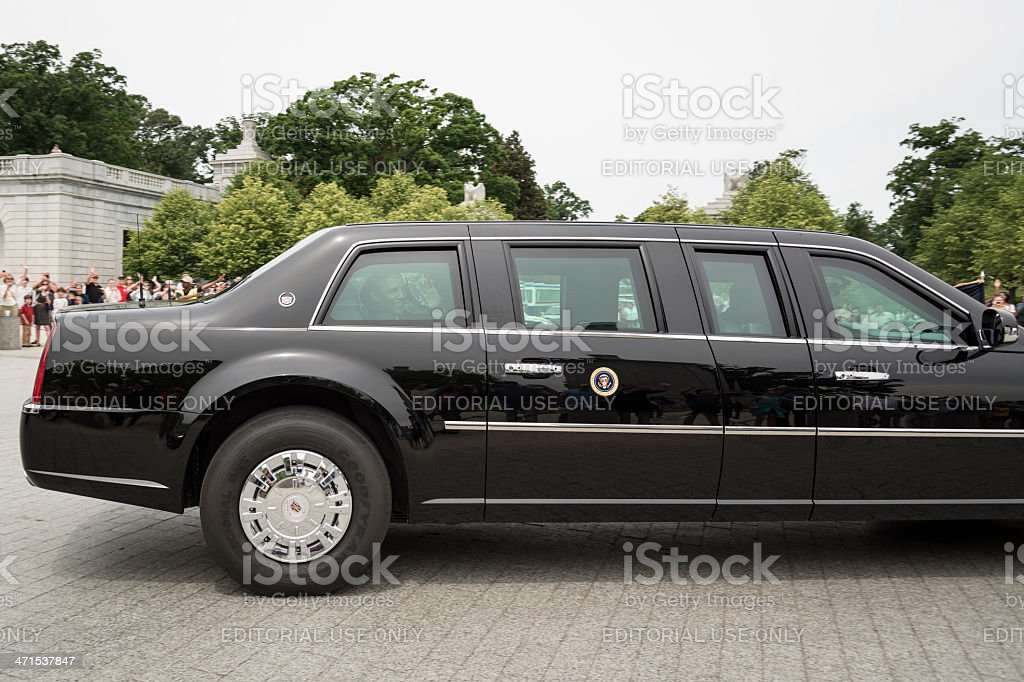 President Obama Smiles and Waves to the Crowd from Limo stock photo