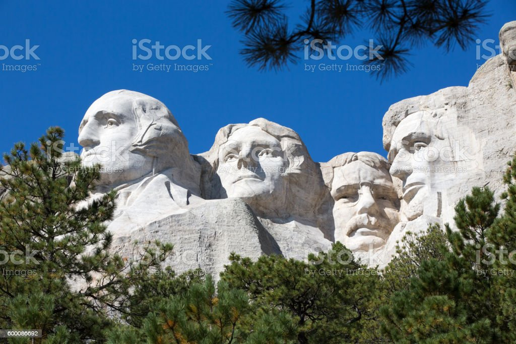 Presidents on Mount Rushmore framed by trees stock photo