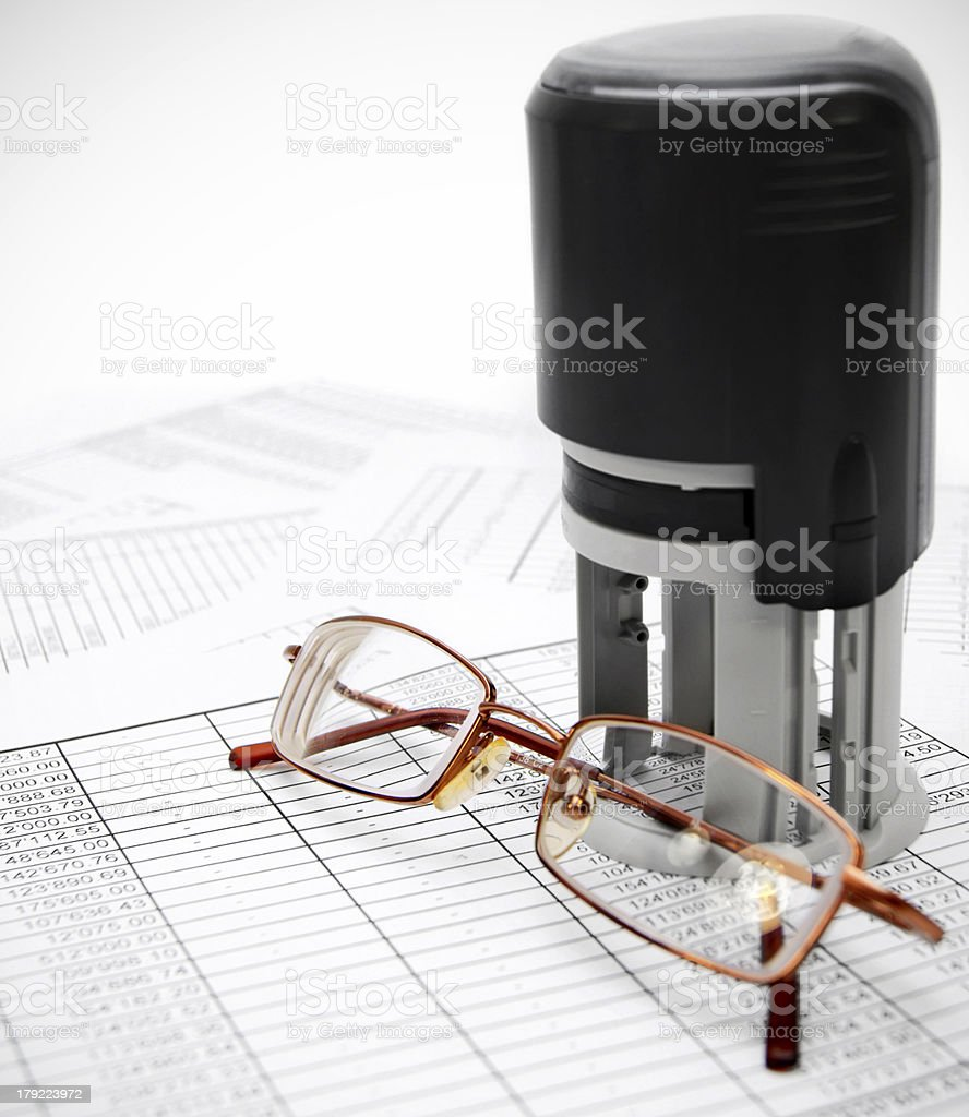 Press and glasses on documents. royalty-free stock photo