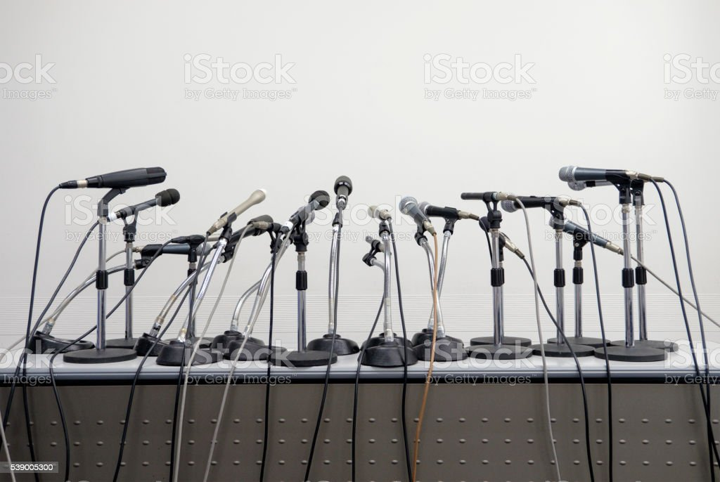 Press Conference Microphone Table stock photo